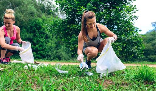 Girl with garbage bag doing plogging