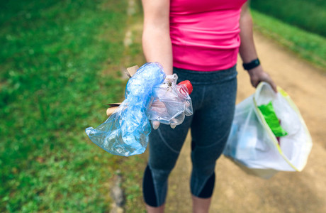 Plogging Girl showing garbage