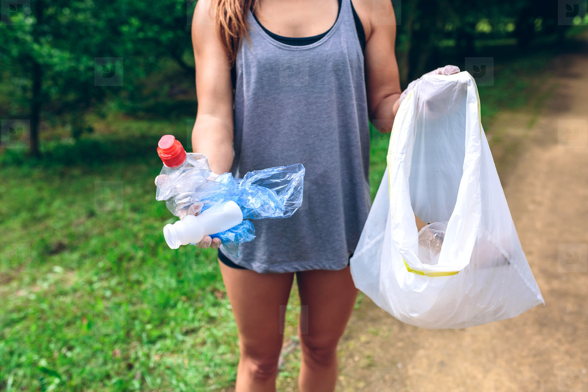 Unrecognizable girl showing garbage