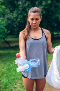 Girl showing garbage she has collected