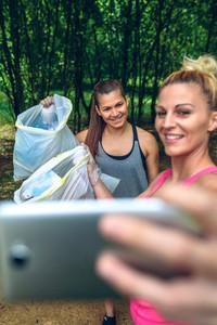 Two girls taking a selfie after plogging