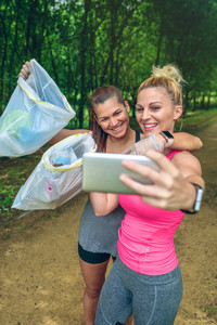 Two girls taking a selfie after plogging