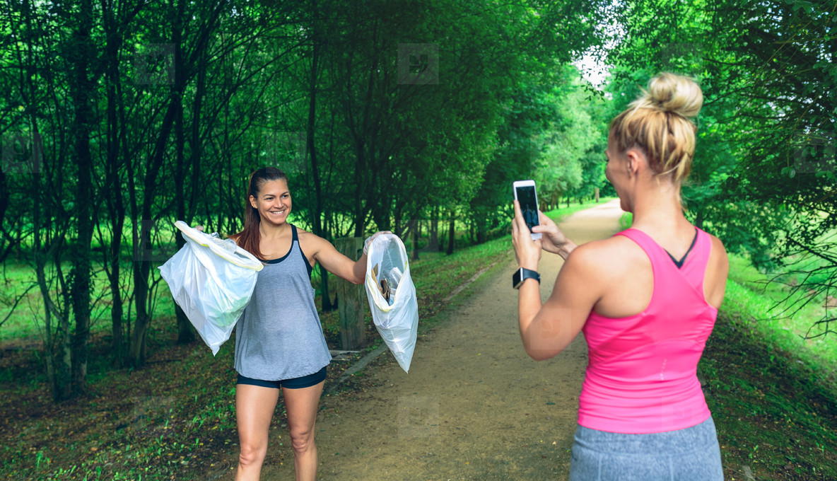 Girl taking picture of a friend after plogging