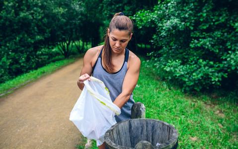 Woman throwing garbage after plogging