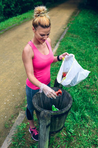 Woman throwing garbage after plogging