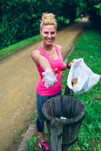 Woman showing garbage after plogging