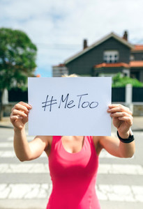 Woman showing poster with metoo hashtag