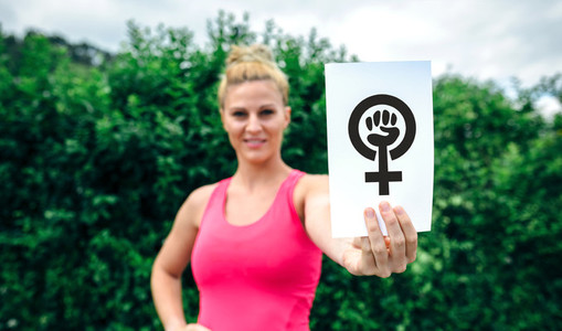 Woman showing symbol of feminism