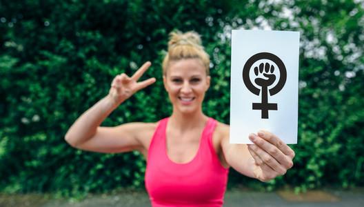 Woman showing symbol of feminism