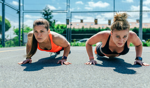 Sportswomen doing push ups