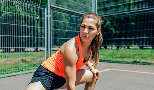 Sportswoman doing leg stretches