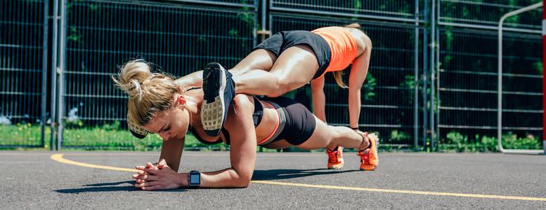 Sportswomen doing partner training
