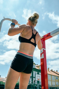 Female athlete doing pull ups in a goal