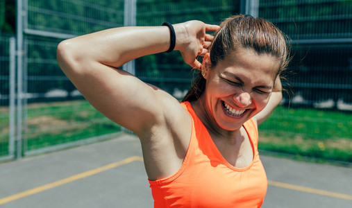 Sportswoman doing arm stretches