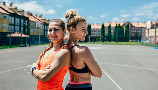 Sportswomen posing with crossed arms