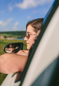 Girl leaning on window of the car