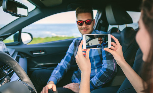 Girl taking picture with mobile to her boyfriend