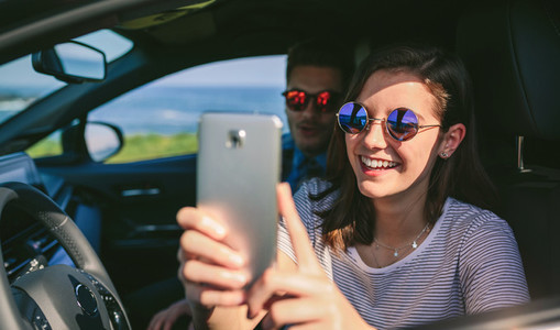 Girl with her boyfriend taking a selfie