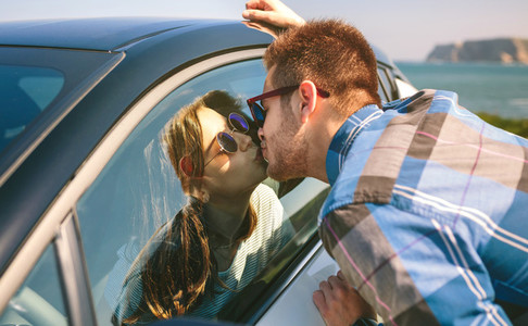 Young couple kissing through the glass