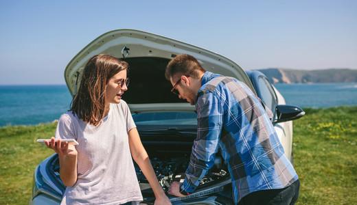 Couple argue while fix their broken down car