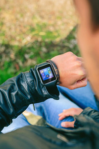 Unrecognizable young man looking at his smartwatch