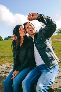 Couple taking a selfie with a smartwatch