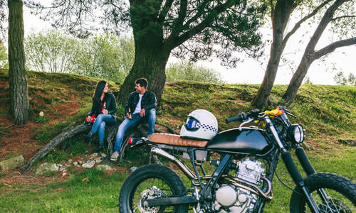 Couple resting from a motorcycle trip