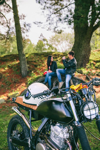 Custom motorbike with young couple