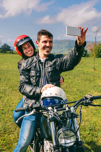 Couple taking a selfie on the motorcycle