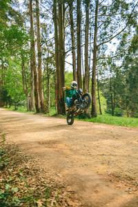 Man with helmet riding custom motorbike