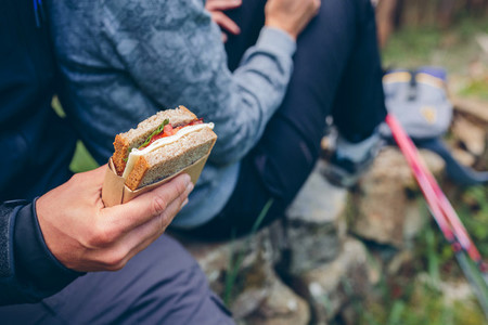 Sandwich that a couple is going to eat doing trekking