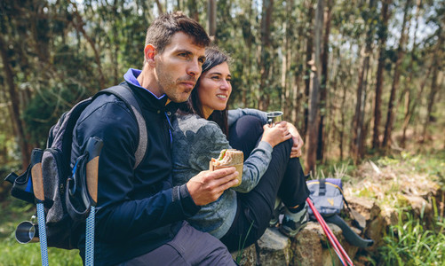 Couple pausing while doing trekking