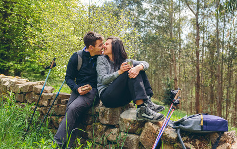 Couple about to kiss while making a break to do trekking