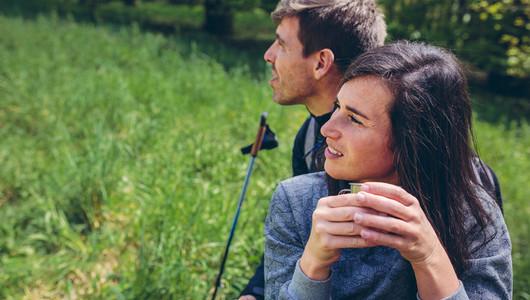 Couple pausing while doing trekking