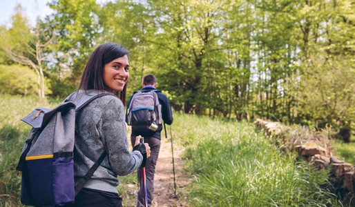 Woman doing trekking looking at camera
