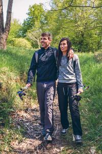 Hikers walking embraced