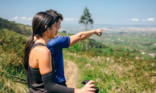 Couple stopping to look the views while doing trail