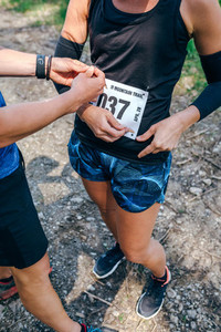 Girl placing the race number