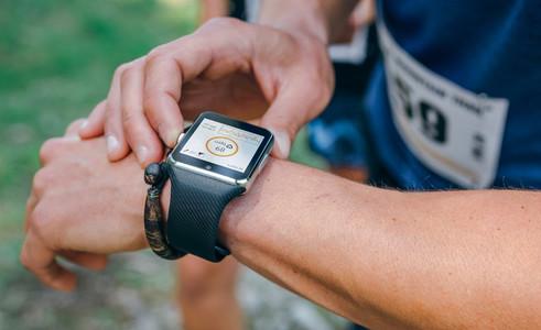 Sportsman looking a smartwatch
