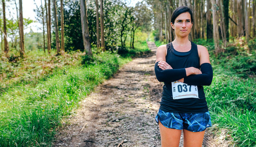 Female trail athlete posing with race number