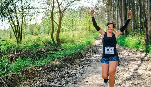 Young woman winning trail race