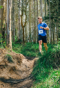 Man participating in trail race