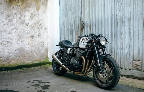 Customized motorcycle in front of garage door