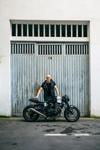 Builder posing with a motorcycle