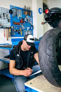 Mechanic checking motorcycle