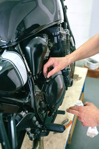 Mechanic repairing customized motorcycle