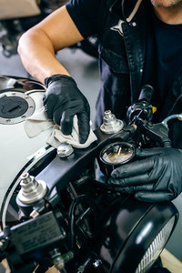 Mechanic cleaning a motorcycle