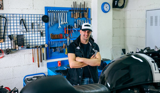 Mechanic posing with a motorcycle
