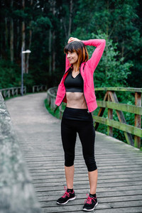 Sportswoman doing stretching arms outdoors