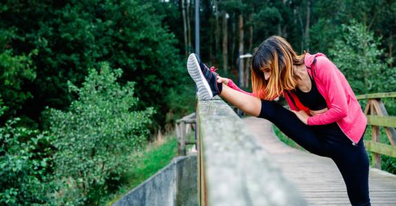 Athlete woman doing leg stretch